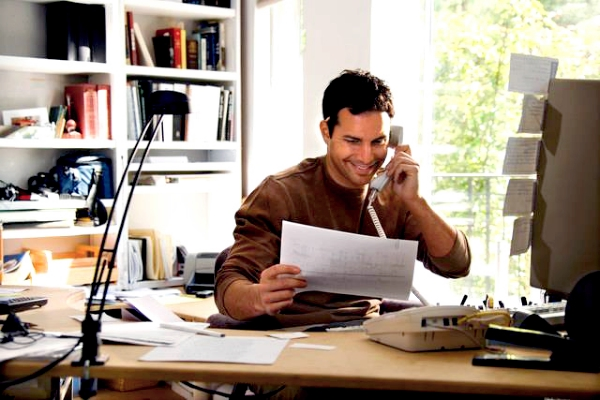 Man Talking on Phone in Home Office
